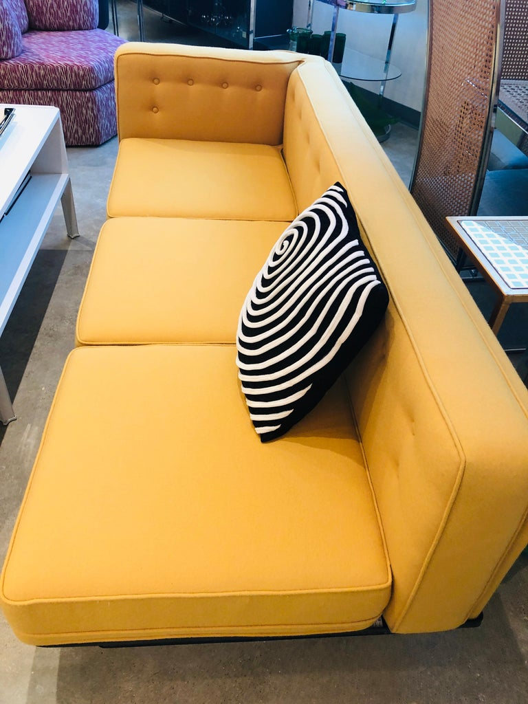Offered are a signed Mid-Century Modern Italian MIM Roma/ Ico Parisi by Luigi Pellegrin sectional sofa newly upholstered in a soft yellow wool Knoll fabric and newly refurbished black fiberglass base. The offered vintage MIM Roma sectional sofa by