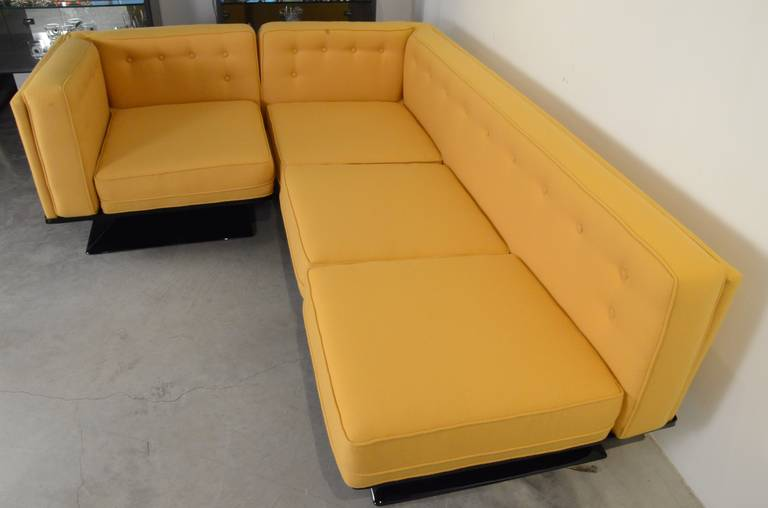 Offered is a signed Mid-Century Modern Italian MIM Roma or Ico Parisi by Luigi Pellegrin sectional sofa newly upholstered in a soft yellow wool Knoll fabric and newly refurbished black fiberglass base. The offered vintage MIM Roma sectional sofa by
