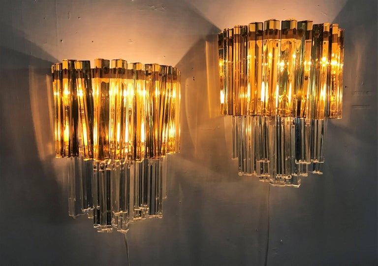 Pair of Mid-Century Modern sconces 'Asta Triedo' model designed by Paolo Venini for Venini and manufactured circa 1960, in two styles of spears, the amber being longer than the clear glass ones. This model is also referred to as 'Triedi' and '