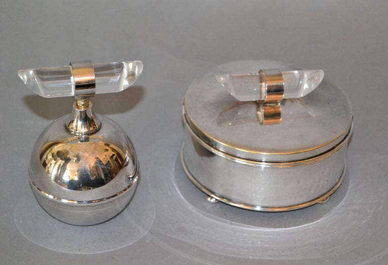 Elegant Mid-Century Modern vanity set comprising a silver plated perfume bottle and a glass bowl with silver plated powder box. The handcrafted Lucite Knob decorate the two pieces. Marked underneath Apollo and Apollo A 1740. These accessories