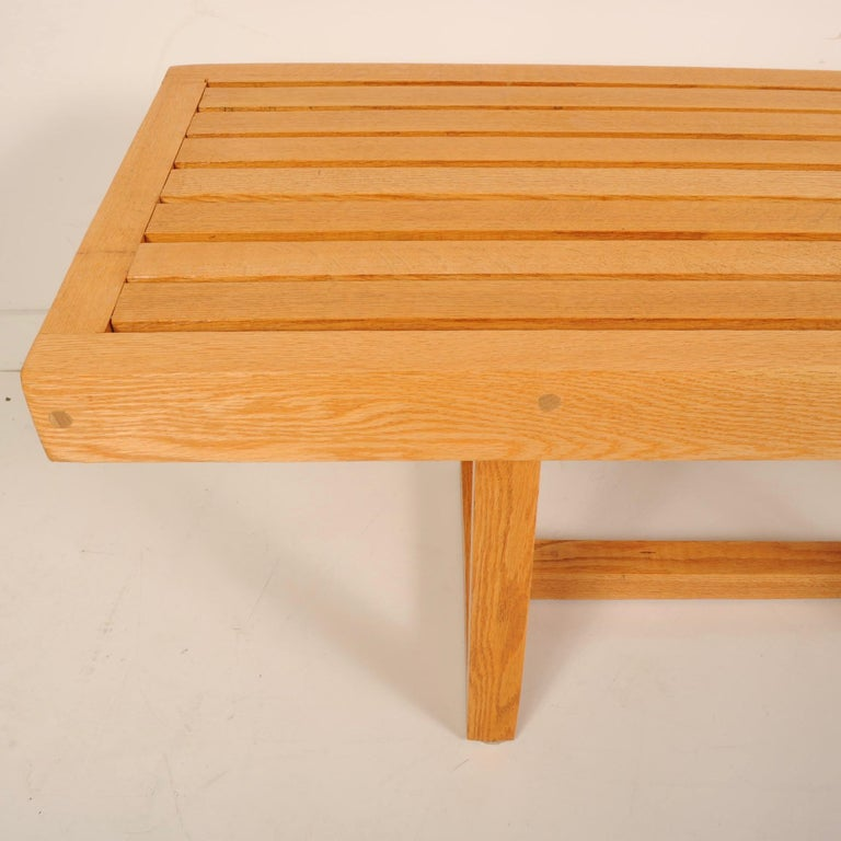 Craftsman-made solid oak bench in the manner of George Nelson, made with wooden pegs instead of glue and screws. Can be used as a bench or coffee table.