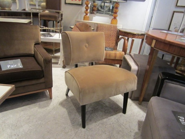 Mid-Century Modern slipper chair on ebonized legs, covered in original brushed cotton.