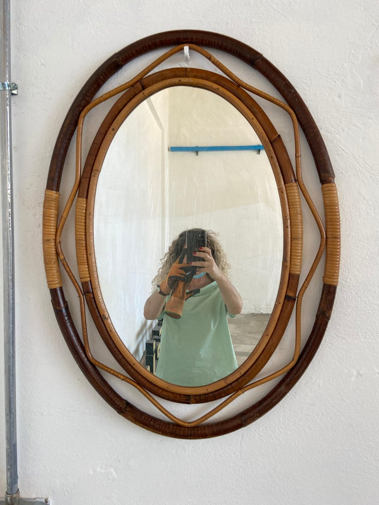Mid-Century Modern Spanish wicker and cane wall mirror with three-tone color frame.