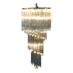 Mid-Century Modern Spiral Eight-Light Brass and Crystal Icicle Chandelier