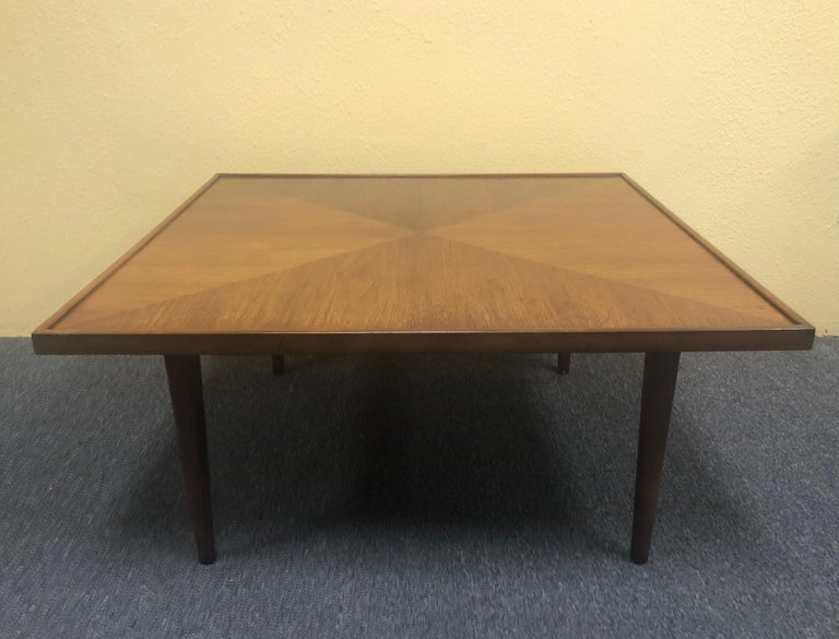 Mid-Century Modern square coffee table in walnut, circa 1970s. The table is 32