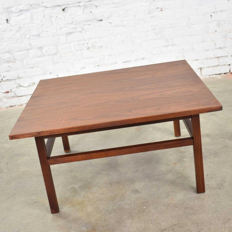 Handsome and versatile Mid-Century Modern walnut cocktail table, coffee table, side table, or end table in the style of Founders Furniture. It is made of solid walnut and in fabulous vintage condition. We have professionally restored the top and