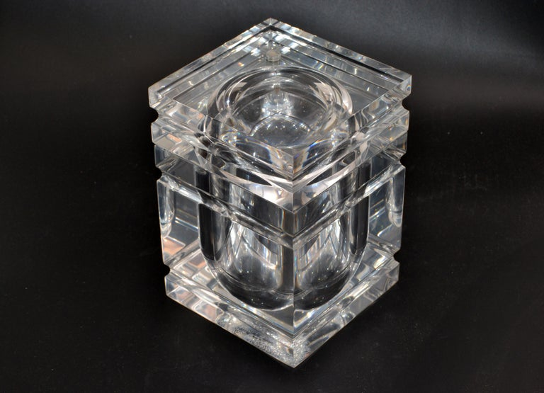 Mid-Century Modern finely detailed ice bucket in Lucite. The tight fitted lid swings open and is attached to the bucket. It is made out of very thick Lucite and is heavy.