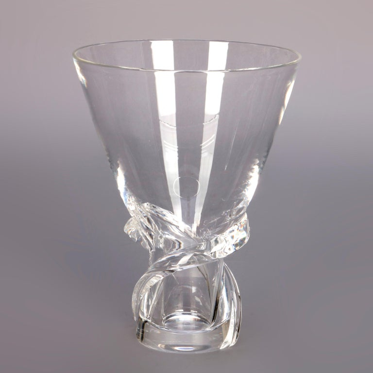 A Mid-Century Modern colorless crystal vase by Steuben Glass Works offers flared form with applied twist element on base, signed as photographed and with box 20th century.  ***DELIVERY NOTICE – Due to COVID-19 we are employing NO-CONTACT PRACTICES