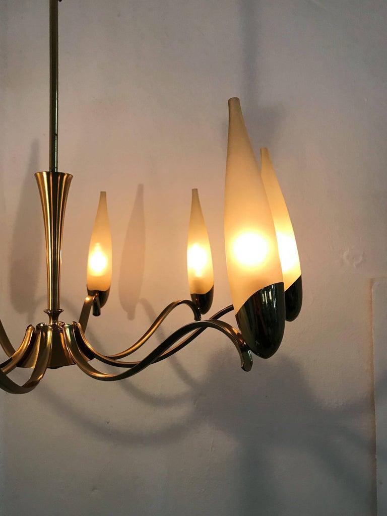 Eight-Light Mid-Century Modern chandelier attributed to Stilnovo, circa 1960.
