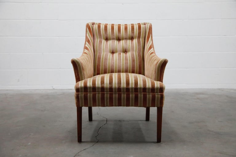 This lovely fireside armchair is upholstered in a beautiful soft striped velvet. Gorgeous striped colors of olive green, white and salmon pink. Sophisticated and classy, soft and cozy - this comfortable armchair is the perfect companion for a good
