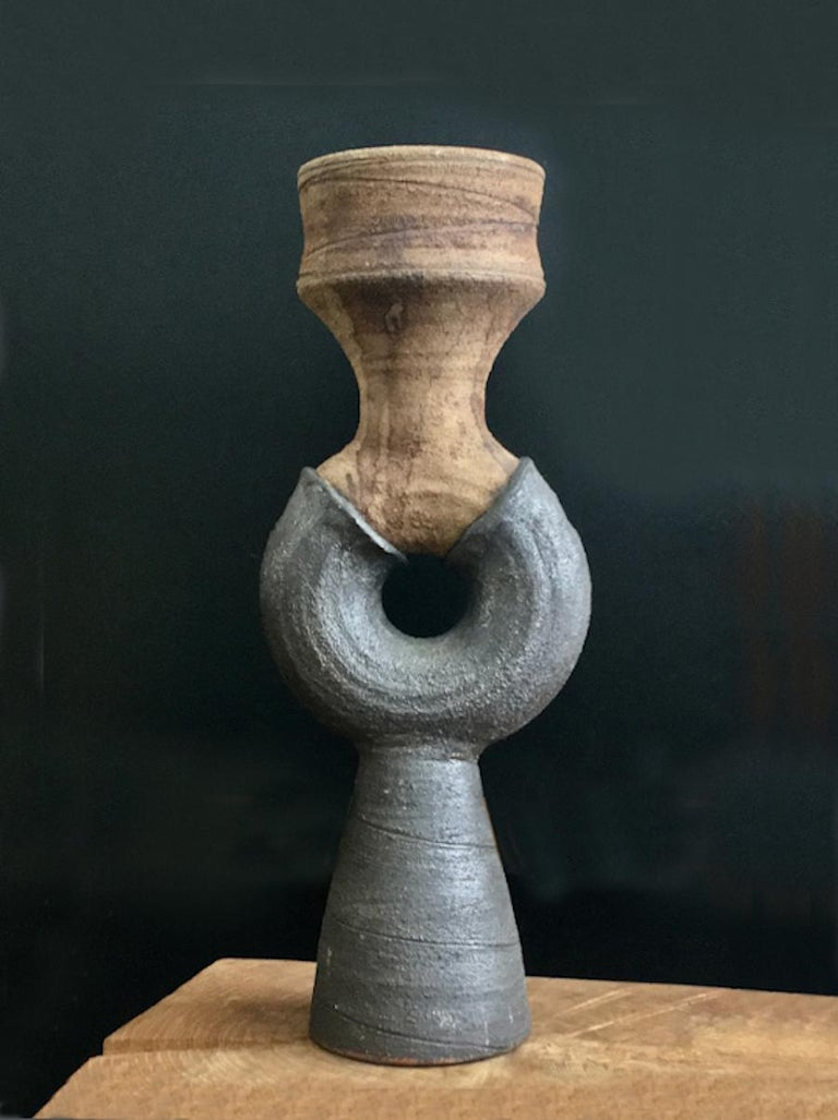 Studio ceramic sculpture by Clive Brooker, mid-20th century, England.  Handmade pottery, with strong silhouette and Brutalist feel. The lower surface is charcoal in color - deep grey/brown - and the upper is brown; both have a matte finish and the