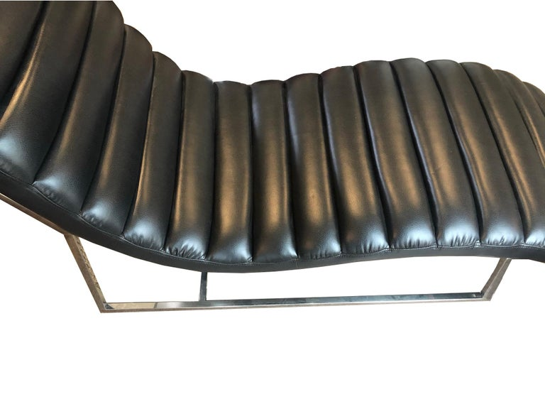 Uber cool channel leather chaise lounge with chrome legs. Modern piece in the style of the midcentury masters such as Le Corbusier. Excellent condition and wonderfully comfortable, this chaise is perfect for any place one wants to be stylish or take