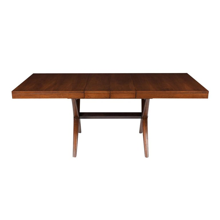 This Vintage Mid-Century Modern Dining Table is made out of walnut wood stained in walnut & black color combination and newly lacquered finish. This writing table features an extendable top with two leave and rests on an X design stretched pedestal