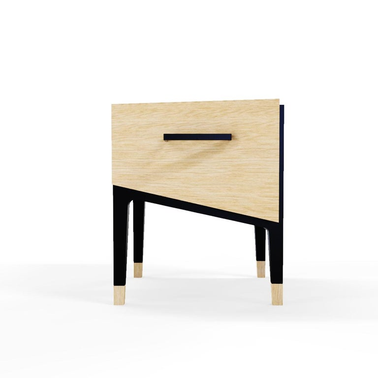 Bring a unique style to your living room with this nightstand. Cut nightstand showcase a semi trapezoid silhouette on four legs featuring a contrasting finish. Easily used as an end table or as a nightstand. Display accessories, vases, flowers or