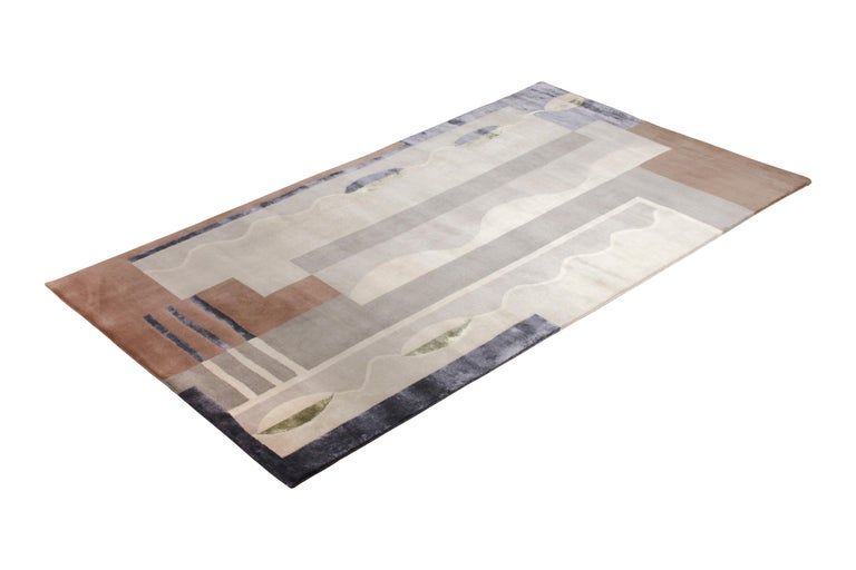 Hand knotted with a bend of New Zealand wool, natural silk, and exotic yarns, this 5 x 9 modern rug hails from the latest prized additions to their acclaimed Mid-Century Modern collection by Rug & Kilim, a bold custom-capable line recapturing an