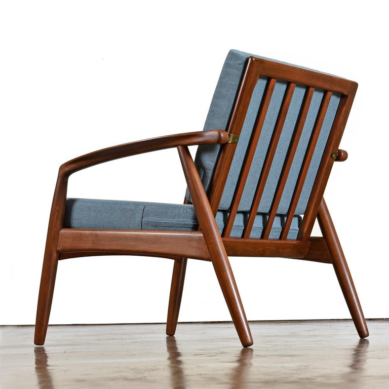 This stunning Danish made lounge chair by Bowa is one of the finest wood frame sofa's we have seen from the period. Vintage early 1960s, Svend Age Madsen expands on the quintessential wood frame armchair to create something truly special. The arched