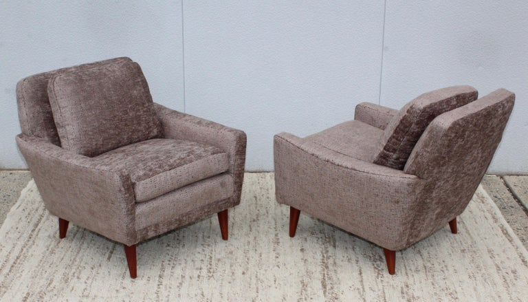 Stunning pair of very heavy and well made lounge chairs by DUX Sweden, with walnut legs newly re-upholstered.