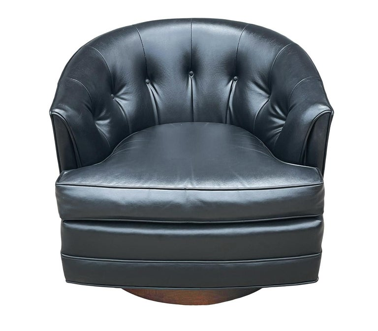 Naugahyde Mid-Century Modern Swivel Barrel Back Lounge Chairs or Club Chairs with Walnut For Sale