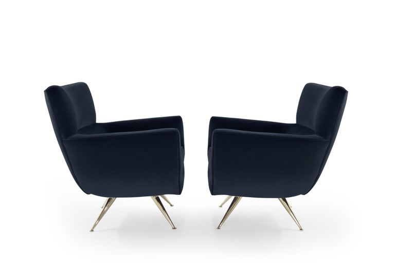 Incredibly rare pair of swivel chairs on brass legs designed by Henry Glass, circa 1950s. Newly upholstered in Great Plains cotton velvet (Midnight) by Holly Hunt. Newly brass-plated legs. Fabric samples available upon request.