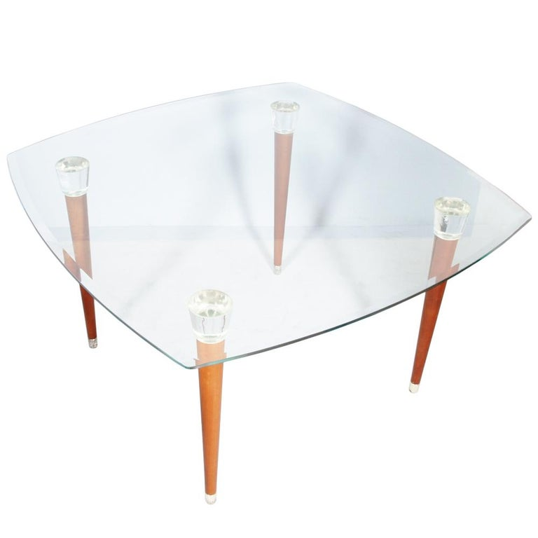 Mid-Century Modern table Ico Prisi style, glass top shaped and polished edge, turned legs in walnut, heads Murano glass. Feet in silver metal.  Measure in cm: H 74 x W 125 x D 125.