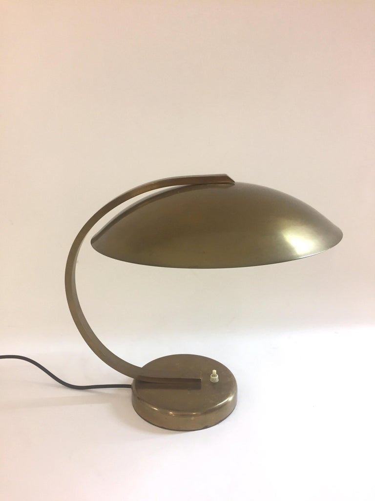 A German Bauhaus style table lamp. Brass frame. Good vintage condition.