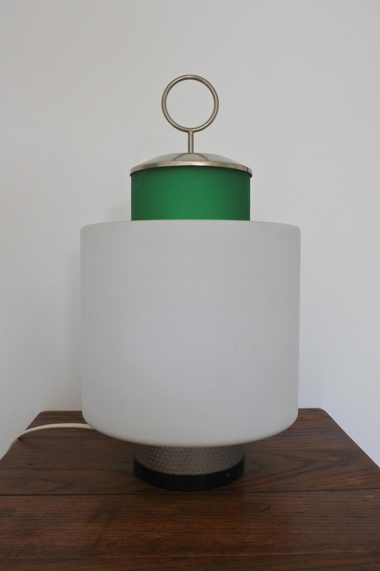 Italian Mid-Century Modern table lamp by Stilnovo. Model 8052.  Designed and made in Italy in 1958. Made from green tinted glass, opaline glass, plated brass and lacquered brass. Original label Stilnovo.  Literature: