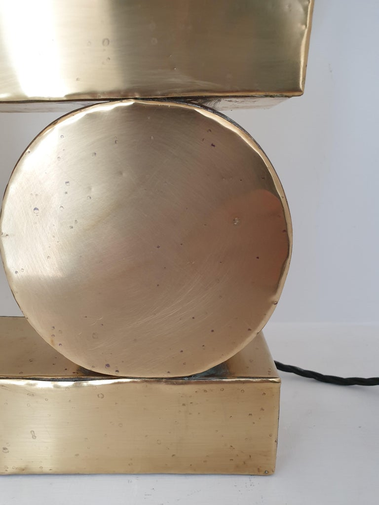 Unusual brass table lamp composed of thin brass sheets welded to a form. In the manner of Pierre Cardin. Please note there are a few areas that have small dents as the brass facing is a soft material.