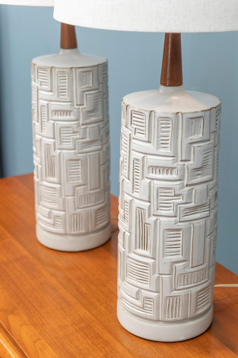 Pair of Mid-Century Modern ceramic table lamps, in very good original condition with new shades.