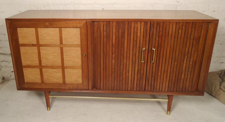 Vintage walnut cabinet with both open storage and drawers. Brass hardware, tambour door doors that recede into the back. Great for bedroom or living room.  (Please confirm item location - NY or NJ - with dealer).