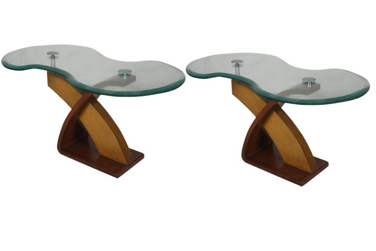 Mid-Century Modern teak and mahogany side or coffee table with chrome hardware. Smoked glass top with a serpentine shape and beveled edges.