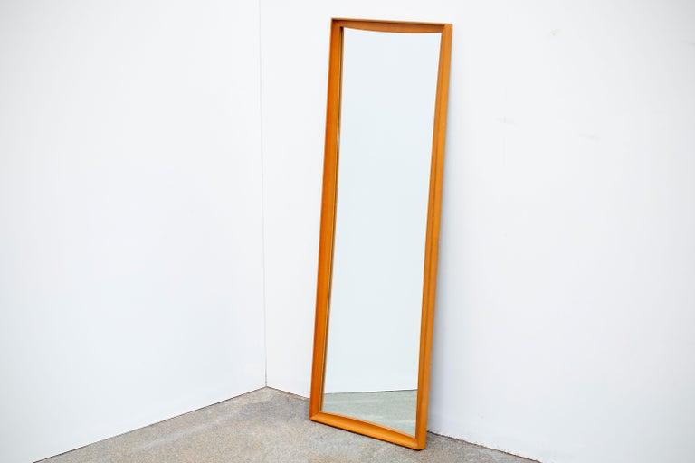 Mid-Century Modern teak framed wall mirror. In excellent original condition.