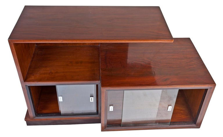 A multi-level Mid-Century Modern teak wood credenza shelves with sliding glass panels on the lower level. The left side is 14