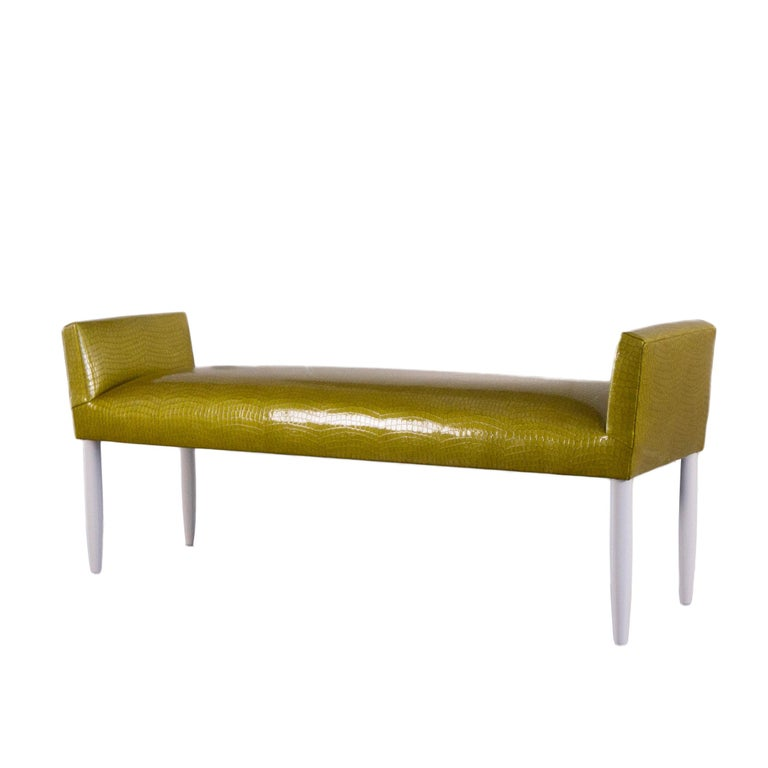 Inspired by Mid-Century Modern furniture, this tight cushioned accent bench is built to order and completely customizable. The bench shown was custom made featuring a green textured vinyl with a Mid-Century Modern tapered legs style painted in white