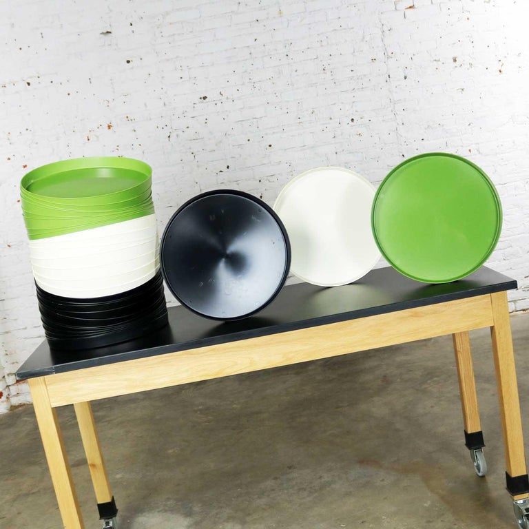 Incredible and fun Mid-Century Modern plastic trays in avocado green, black, and white. Called Splatter Platters and manufactured by Sabe's of Fort Smith, Arkansas. They are in wonderful condition. Most have never been used. Some have minor scuffs