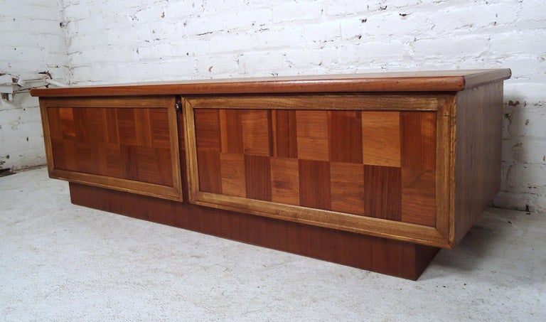 Beautiful vintage modern cedar chest by Lane featuring a two-tone checker designed front.