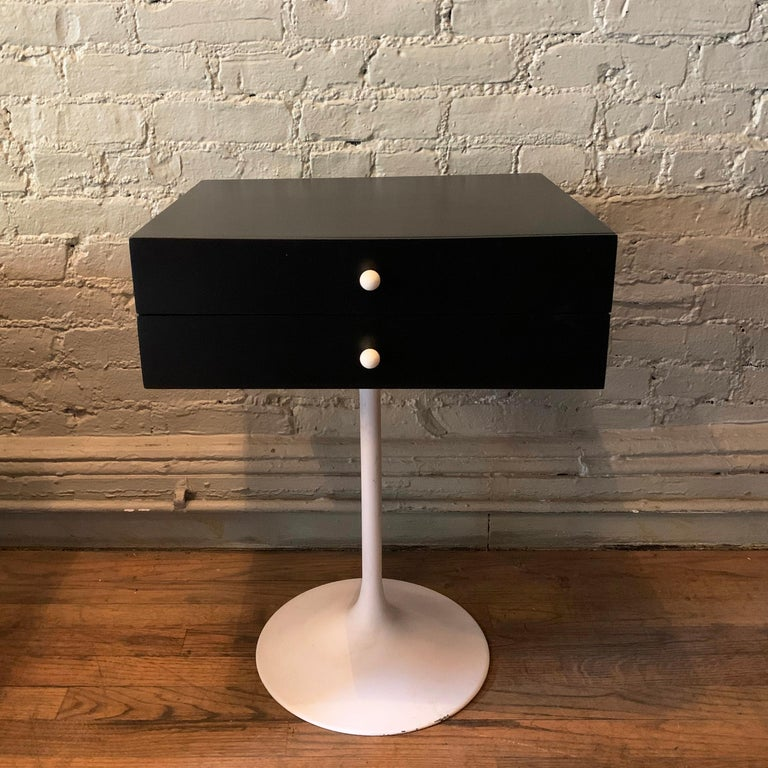 Mid-Century Modern, side table or nightstand features a white tulip base with contrasting black, two drawer top with white porcelain pulls. Cabinet height is 6 inches.