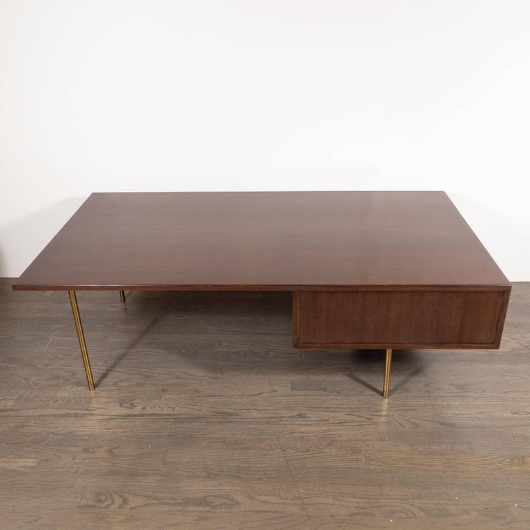This elegant and refined cocktail table was designed by Harvey Probber and handmade in Fall River, Massachusetts circa 1960. Probber believed that