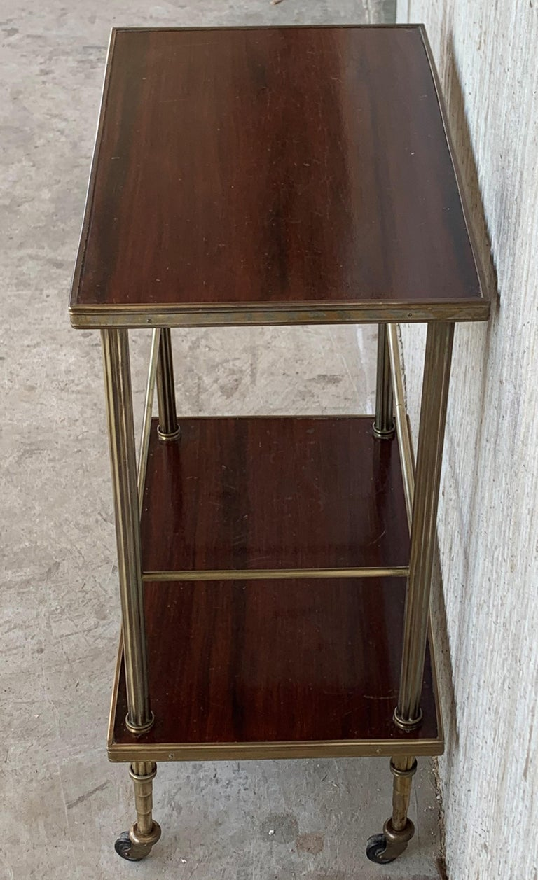 20th Century Mid-Century Modern Two-Tier Brass and Mahogany Veneer Side Table with Wheels For Sale
