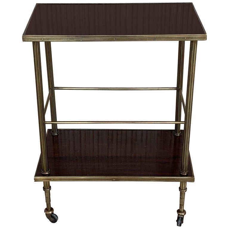 Mid-Century Modern Two-Tier Brass and Mahogany Veneer Side Table with Wheels For Sale