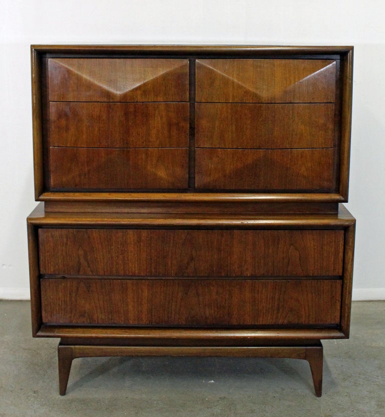 Offered is large tall chest dresser made by United. Features six smaller top drawers with sculpted fronts and two large drawers on bottom with hidden side pulls. Drawers are dovetailed. It is in good condition, shows normal age wear (surface