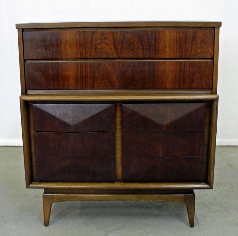 Offered is tall chest dresser made by United. Features two top drawers and four underneath with sculpted fronts and hidden side pulls. Drawers are dovetailed. It is in excellent condition, shows minor age wear (refinished, minor surface wear--see