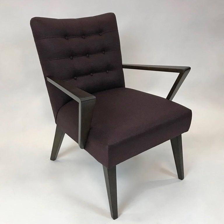 Elegant, Mid-Century Modern, armchair features a sculptural ebonized maple frame with aubergine cotton linen blend upholstery.