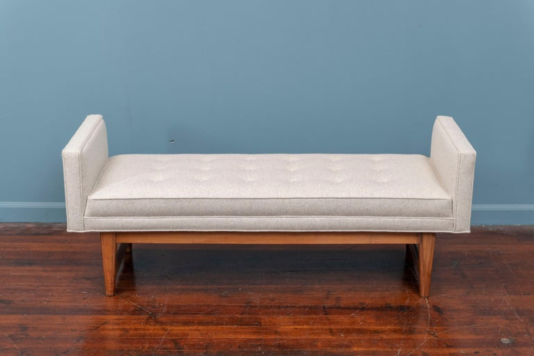 Mid-Century Modern bench by Selig, newly upholstered in a light gray/oatmeal felt on a walnut frame. In very good condition and ready to install, perfect for the end of the bed.
