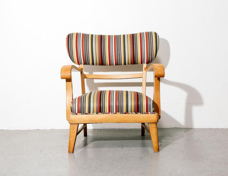 Mid-Century Modern lounge chair upholstered in vintage Paul Smith for Kvadrat striped fabric over a sculpted blonde wood frame.