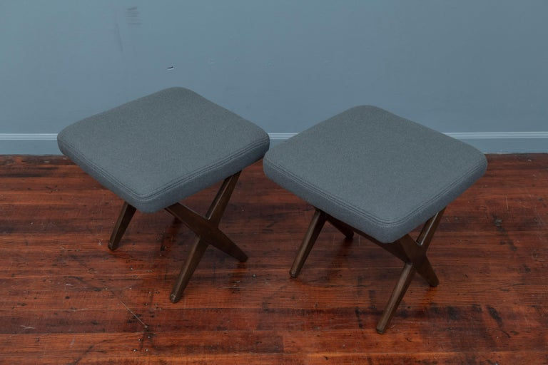 Folke Ohlsson for DUX stools with new teal wool upholstered seats on fruitwood X-form bases.
