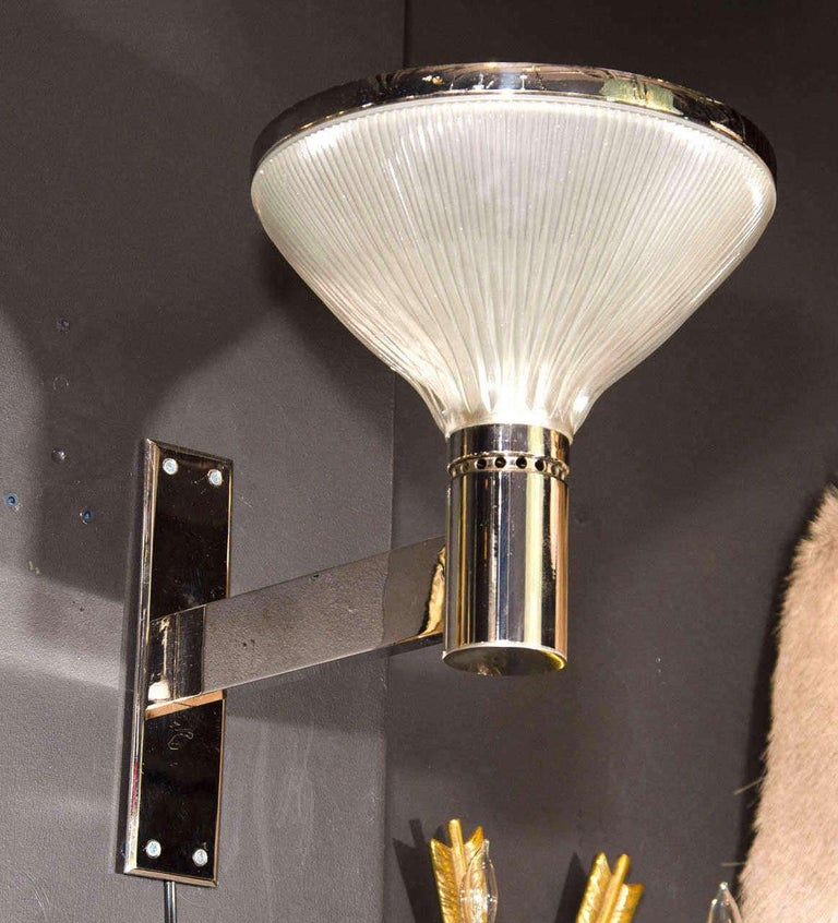 Mid-Century Modern torchiere uplight sconces with Art Deco and Machine Age inspired design. They feature bold polished chrome frames with extended arm design and fluted opaline glass domes with chrome banded tops. Sconces have a prominent design and