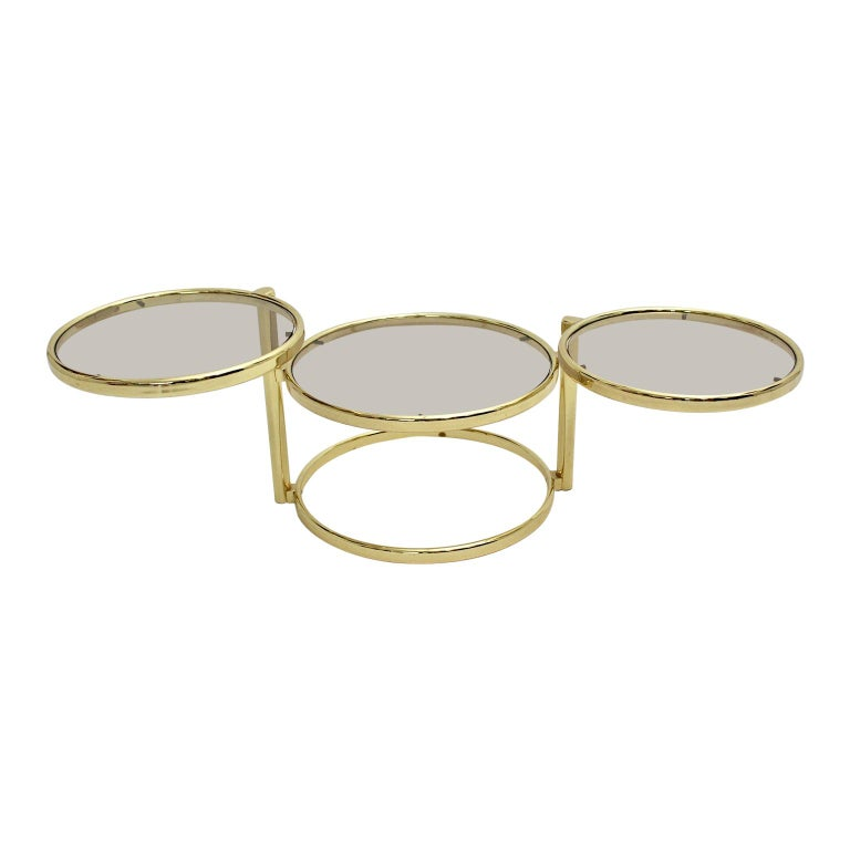 Mid-Century Modern Vintage Brassed Metal Glass Swiveling Coffee Table circa 1970 For Sale