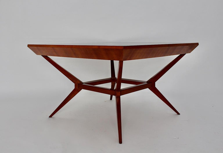 A Mid-Century Modern vintage cherrywood dining table or center table, which was designed by Franz Schuster attributed, Vienna, 1950s. This outstanding furniture piece was designed and manufactured in the heart of Europe, Austria, Vienna and shows a