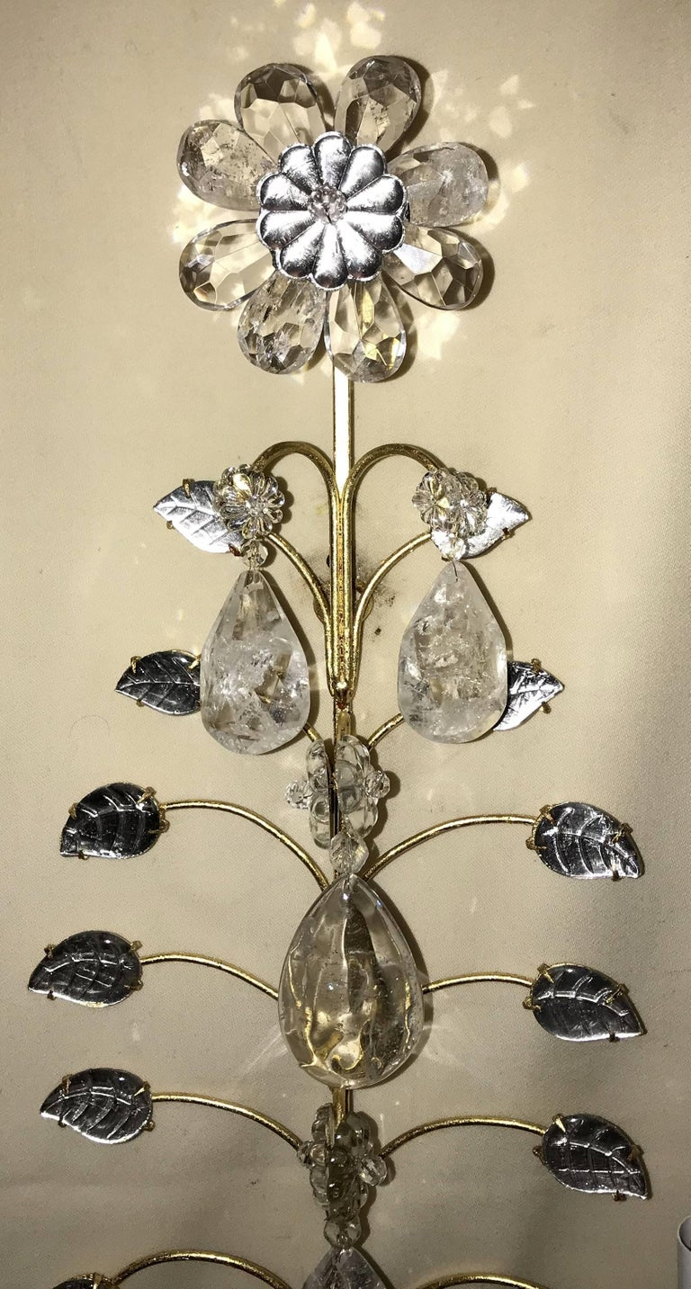 A wonderful Mid-Century Modern vintage pair of Baguès rock crystal gold gilt flower wall sconces.