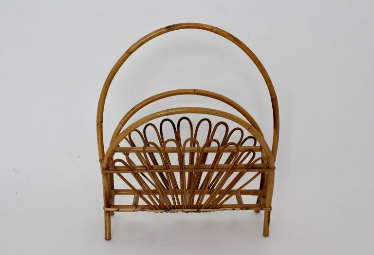 Charming Vintage Riviera style magazine rack from the 1950s, Italy, which was made of rattan.  approx. measures: Width 52 cm Depth 25.5 cm Height 60 cm Very good condition without damages or defects.